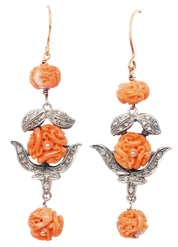 A pair of coral diamond earrings