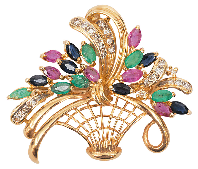 A flower brooch with sapphires, emerads and rubies