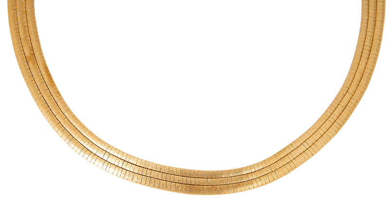 A gold necklace with matching bracelet