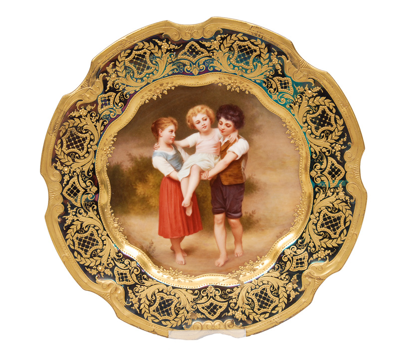 "A plate ""Children playing"" with gilded decor"