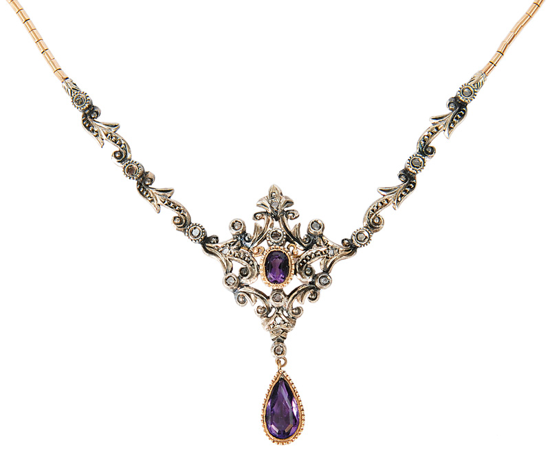 An antique amethyst necklace in the style of Hugo Schaper