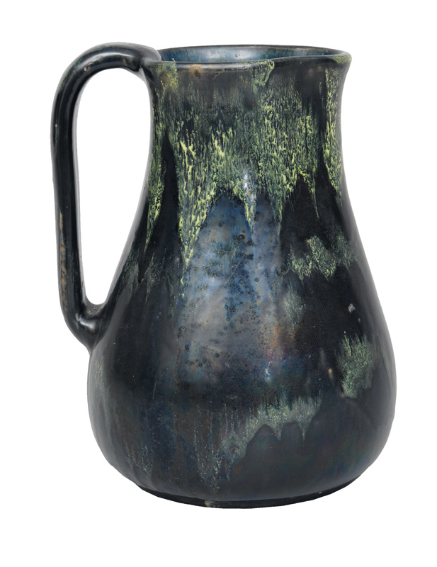 An Art Nouveau carafe with running glaze
