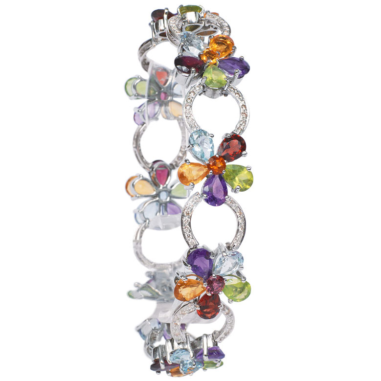 A bracelet rich jewelled with coloured gemstones