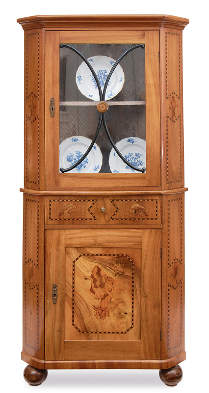 A corner cabinet with inlaid work
