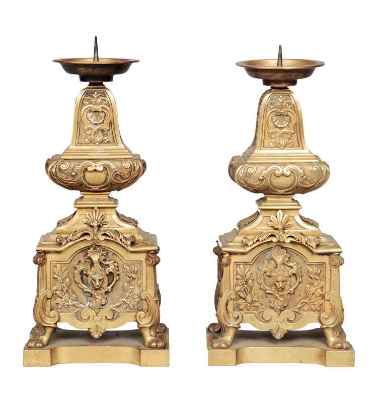 A pair of Louis-Quinze candle holders with masks of lions