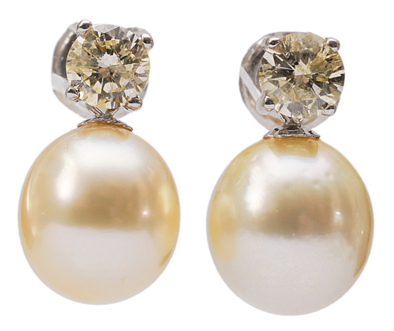 A pair of pearl earrings with diamonds