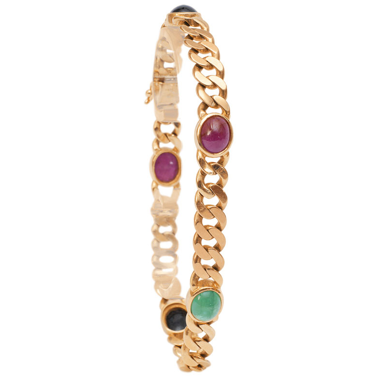 A golden bracelet with sapphire, ruby and emerald