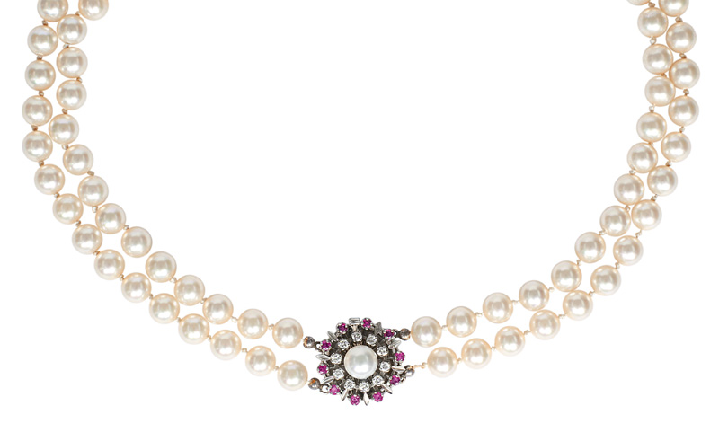 A pearl necklace with a diamond ruby clasp