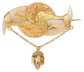 An antique claw brooch with golden mounting