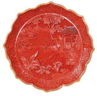 A red laquer plate with landscape