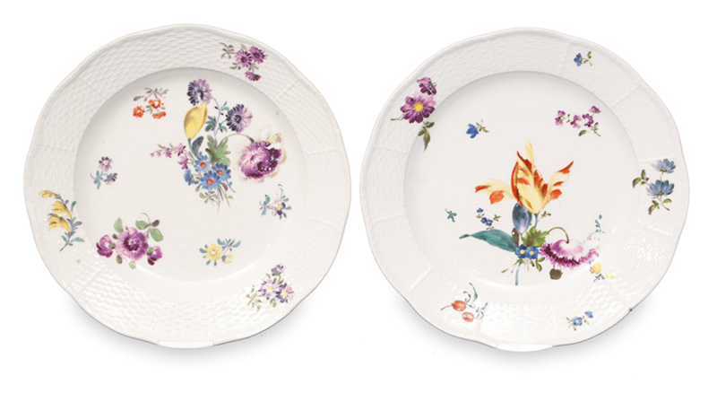 A pair of plates with floral decoration and Ozier relief
