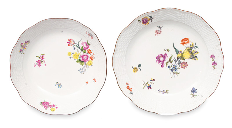 A pair of bowls with floral decoration and Ozier relief