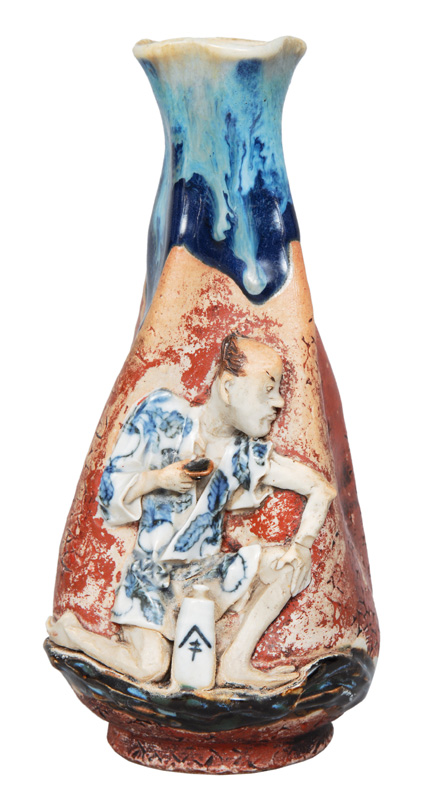 A bottle-shaped vase with figural relief