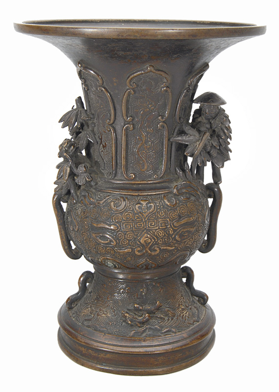 A bronze vase with tiger, huntsman and taotie masks