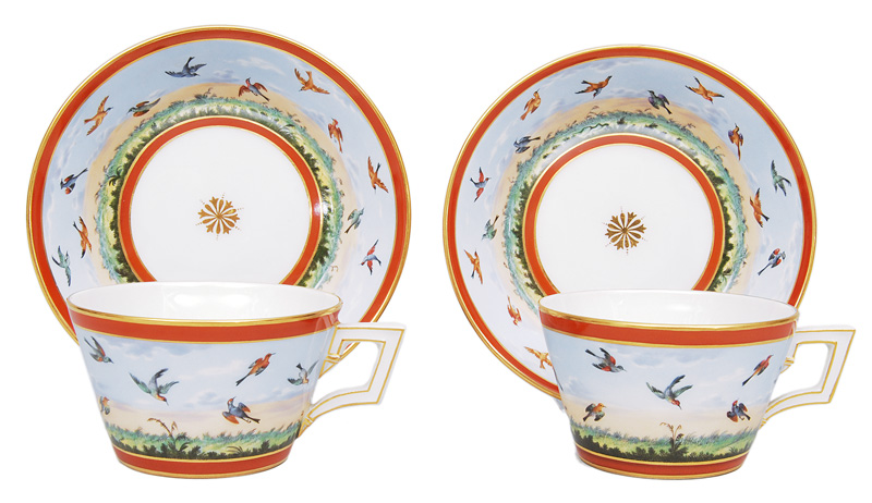 A pair of cups with painting of birds