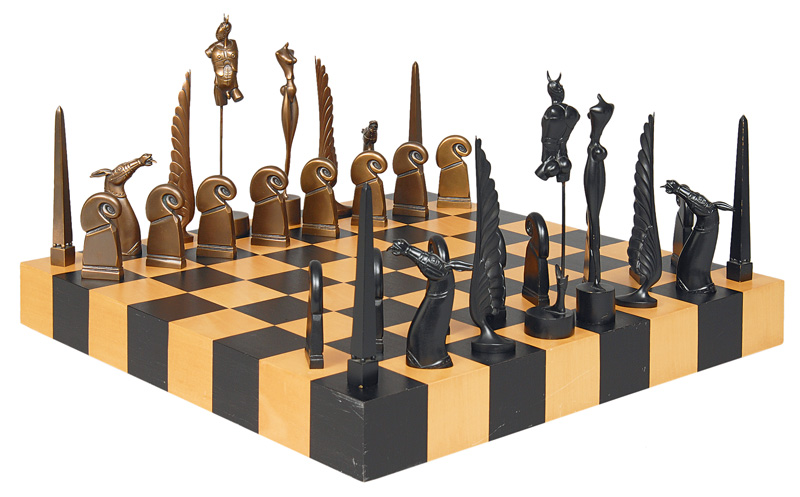 A chess game with board and bronze figures