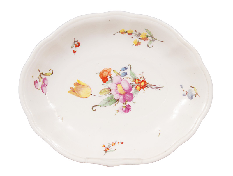 A curved bowl with flower painting