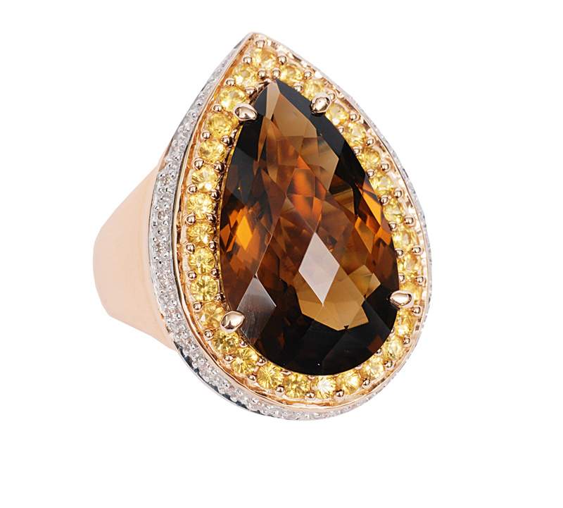 A smoky quartz ring with diamonds and yellow sapphires