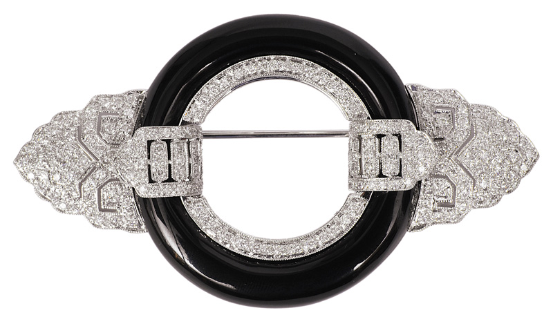 An onyx Art-déco brooch with diamonds