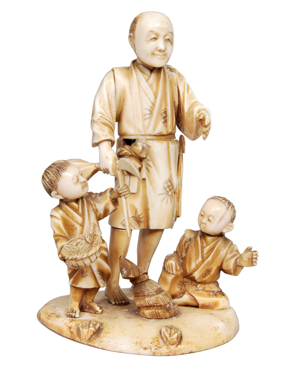 An okimono - man with two children