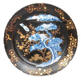 An Arita plate with black lacquere