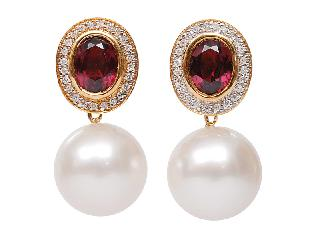 A pair of Southsea pearl earpendants with rhodolit-diamond top