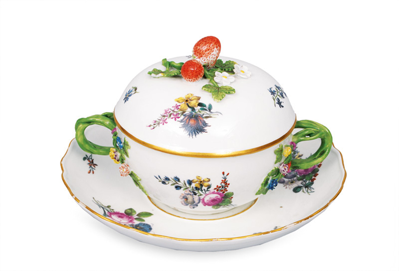 A small tureen on saucer with fine flower painting