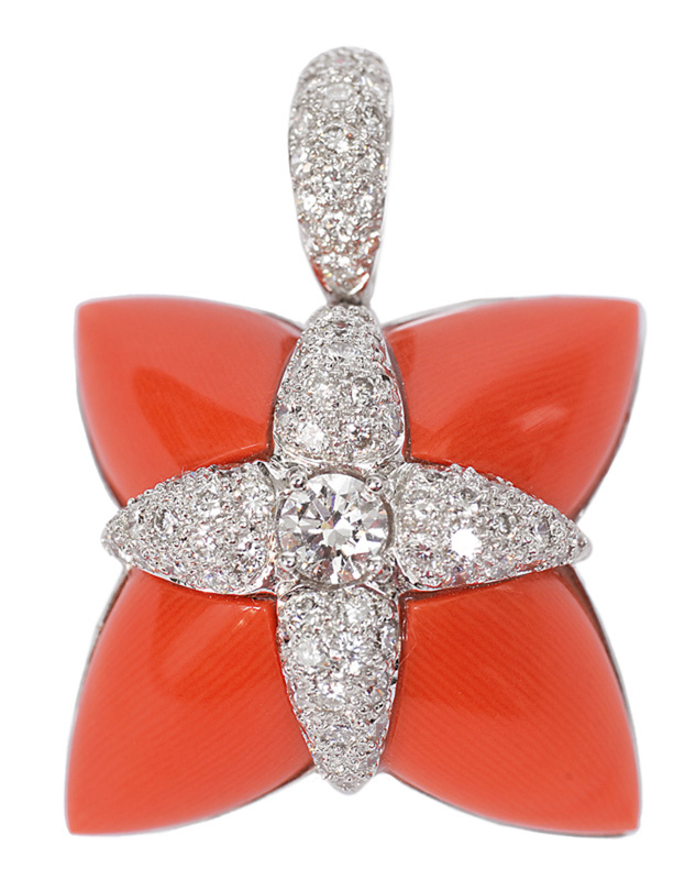 A coral diamond pendant with necklace
