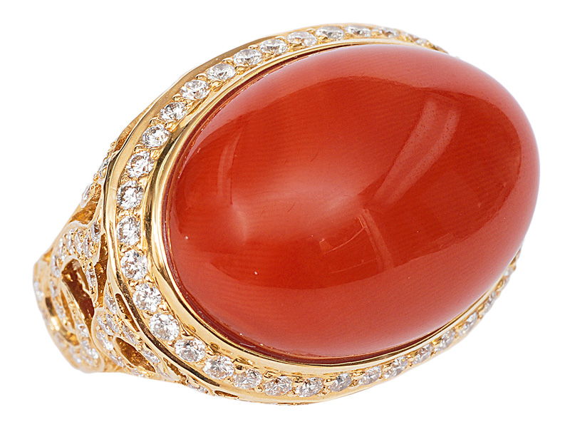 A coral diamond ring