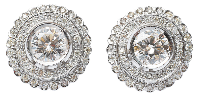 A pair od solitaire earrings with diamonds