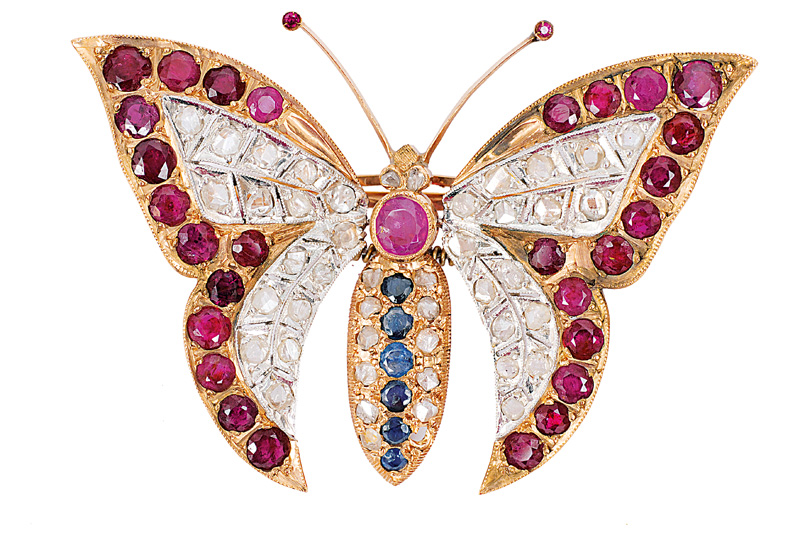 A butterfly brooch with rubies, diamonds and sapphires