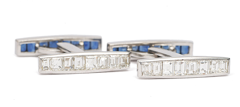 A pair of cuff links with diamonds and sapphires