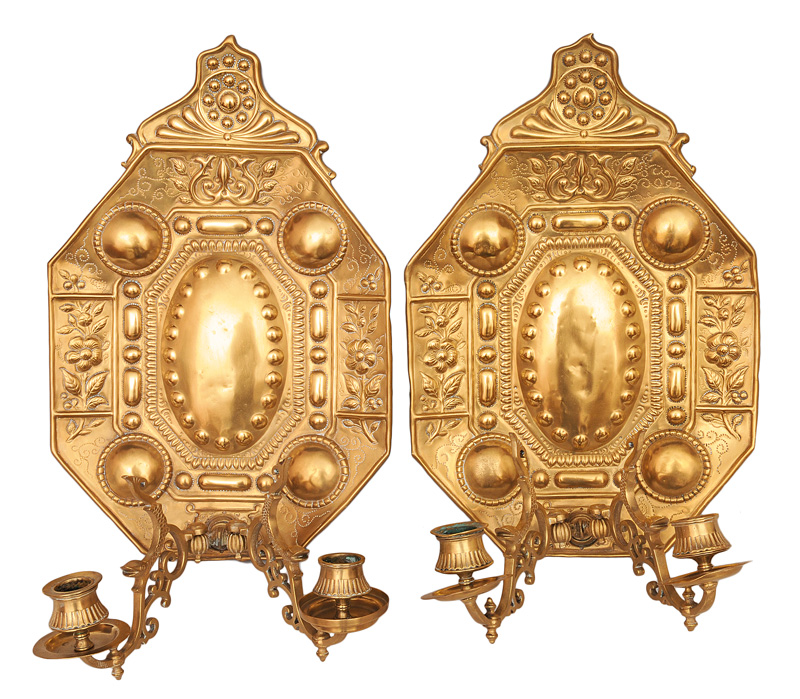A pair of wall lights with blossom decoration