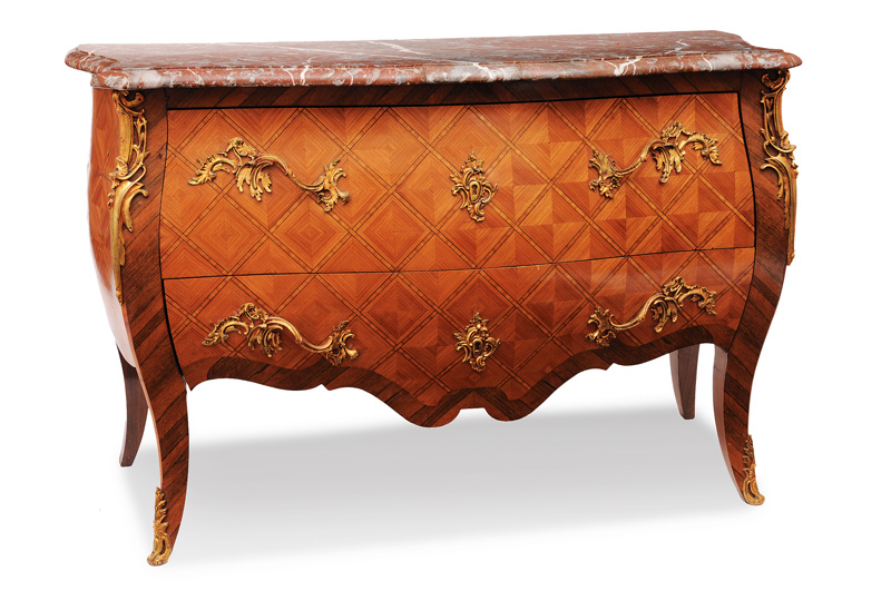 A great chest of drawers with lattice marqueterie in the style of Louis Quinze