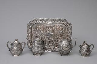 A tea service with elephant handles