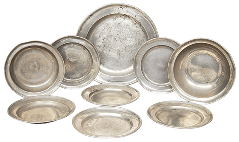 A set of 9 tin dishes