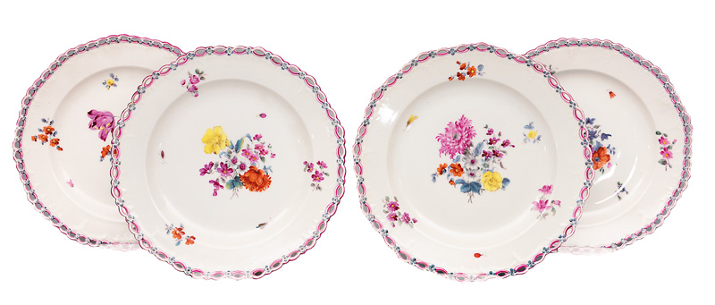 A set of 4 plates with garland-fretwork