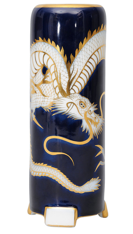 A cylindrical vase with dragon decoration
