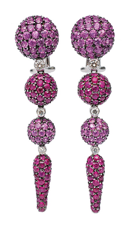 A pair of long earclips with rubies and pink sapphires