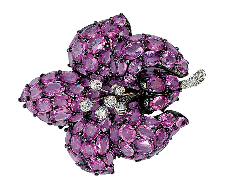 A flowershaped brooch with pink sapphires and diamonds