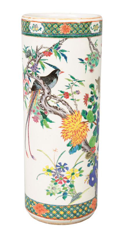 A tall cylindrical vase with bright flower painting