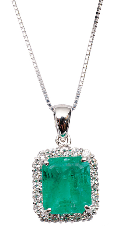 A fine emerald diamond pendant with necklace