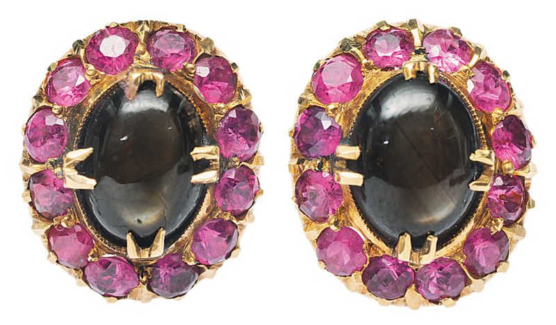 A pair of star sapphires earstuds with rubies
