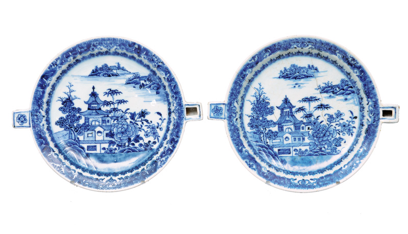 A pair of warming dishes with garden scene