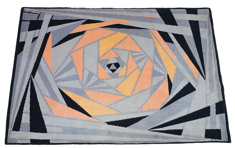 An Art Deco carpet with geometric abstract decor