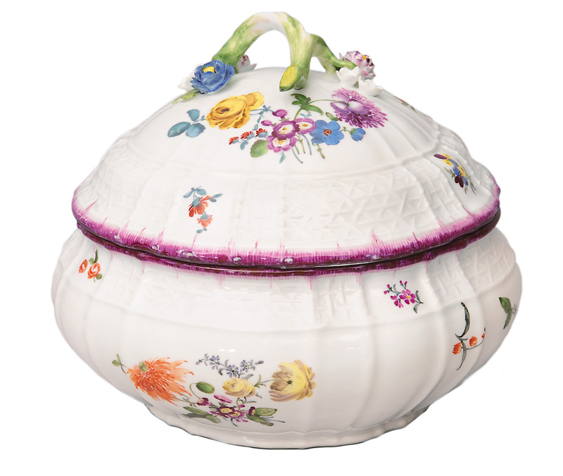 A tureen with cover and flower decoration