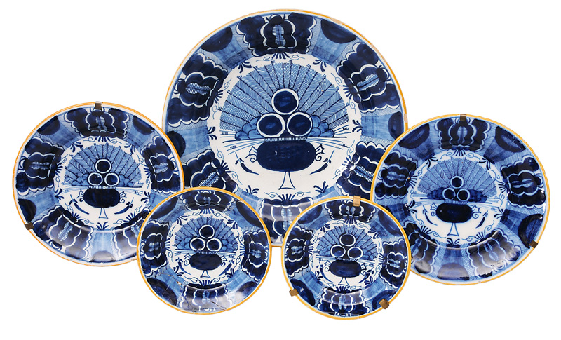 A set of 5 plates with peacock decor