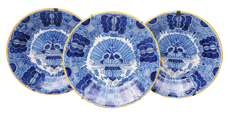 A set of 3 plates with peacock decor
