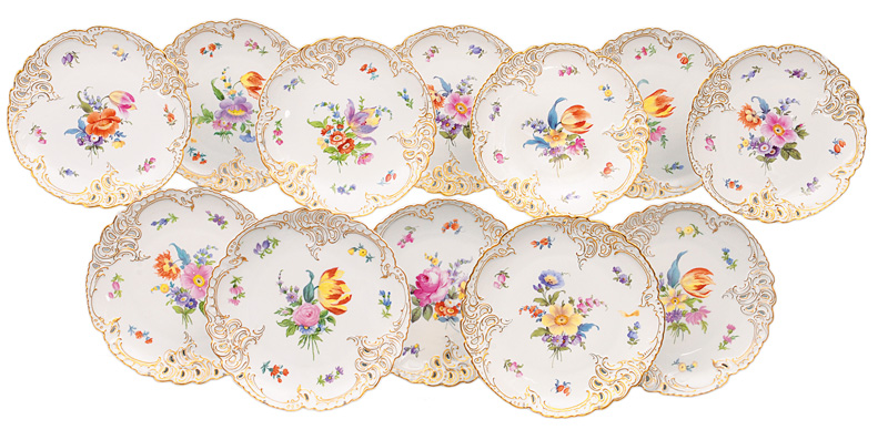 A set of 12 fretwork plates with bouquets and scattered flowers