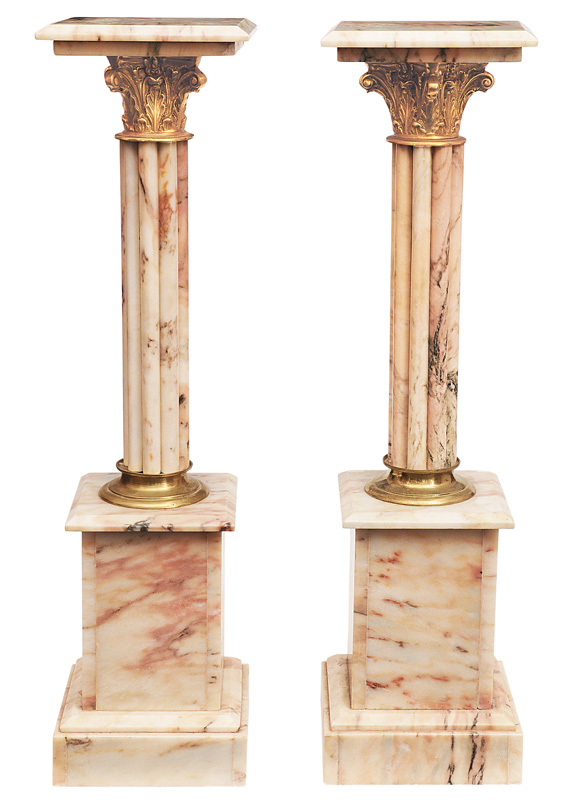A pair of decorative marble columns